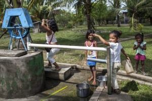 Girls get water from a well with a pump in Butku, RAAN, Nicaragua, 2014.